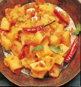 Potato curry .  Free tutorial with pictures on how to cook an aloo curry in under 45 minutes by cooking with sunflower oil, onion, and plum tomatoes. Recipe posted by DK Books.  in the Recipes section Difficulty: Simple. Cost: Cheap. Steps: 3