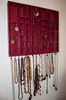 Get a beautiful jewelry display from trash .  Free tutorial with pictures on how to make a necklace organizer in 10 steps by constructing with drawer, hooks, and wood. How To posted by Daniela S.  in the Home + DIY section Difficulty: Simple. Cost: Cheap.