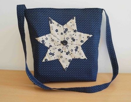 A project to start with paper piecing and make a simple bag .  Free tutorial with pictures on how to sew a patchwork tote in 11 steps by sewing and patchworking with interlining, freezer paper, and cotton thread. How To posted by Maria P.  in the Needlework section Difficulty: 3/5. Cost: 3/5.