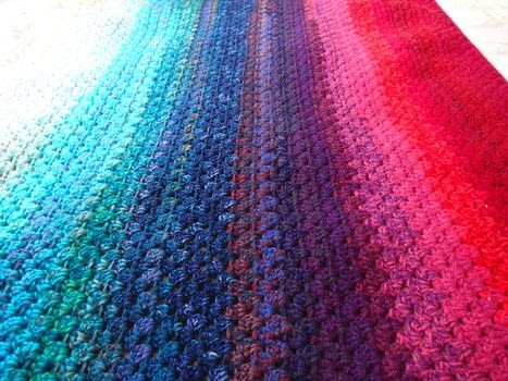 Simple crochet blanket that looks like the Aurora Borealis .  Free tutorial with pictures on how to stitch a knit or crochet blanket in 7 steps by yarncrafting with darning needle, bulky yarn , and dk yarn. How To posted by natashaprice.  in the Yarncraft section Difficulty: Simple. Cost: No cost.