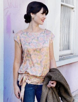 Sew Over It Vintage .  Free tutorial with pictures on how to make a wrap top in 9 steps by sewing and dressmaking with fabric and sewing machine. Inspired by vintage & retro. How To posted by Ebury Publishing.  in the Sewing section Difficulty: 3/5. Cost: 3/5.