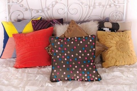DIY Bedroom Décor .  Free tutorial with pictures on how to make an embellished cushion in under 25 minutes by embellishing with pillow form, pompoms, and glue gun. How To posted by FW Media.  in the Decorating section Difficulty: Simple. Cost: Cheap. Steps: 4