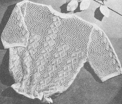 Knitted Elegance After Blouse In Lace Stitch .  Free tutorial with pictures on how to stitch a knit or crochet top in 3 steps by knitting with wool, knitting needles, and  buttons. How To posted by Osprey Publishing.  in the Yarncraft section Difficulty: 3/5. Cost: 3/5.