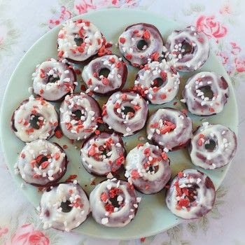 Mini baked red velvet donuts with cream cheese glazes and meringue sprinkles .  Free tutorial with pictures on how to bake a donut in under 45 minutes by cooking and baking with plain flour, sugar, and cocoa. Recipe posted by Cat Morley.  in the Recipes section Difficulty: Simple. Cost: Cheap. Steps: 10