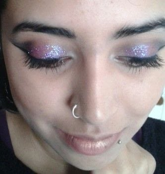 Create a Lily Allen inspired Dramatic Glittery Smokey Eye .  Free tutorial with pictures on how to create a glitter eye in under 60 minutes by applying makeup and applying makeup with eyeshadow, cosmetic glitter, and eyeliner. Inspired by lily allen. How To posted by mariya p.  in the Beauty section Difficulty: Simple. Cost: Cheap. Steps: 4