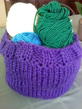 I needed to clean out my yarn stash a while back, so I figured, why not use my yarn to hold my other yarn? :) .  Free tutorial with pictures on how to stitch a knit or crochet basket in under 90 minutes by yarncrafting and knitting with bulky yarn , scissors, and darning needle. How To posted by Violette Lovelace.  in the Yarncraft section Difficulty: Easy. Cost: Absolutley free. Steps: 4