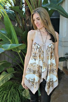 A DIY Halter Top Using Scarves .  Free tutorial with pictures on how to make a strapless top in under 45 minutes by hand sewing and machine sewing with scarf, thread, and lace. How To posted by FreeUrCloset.  in the Sewing section Difficulty: Easy. Cost: Cheap. Steps: 4