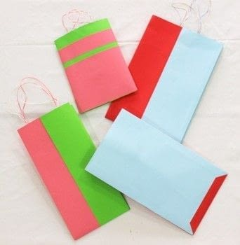 Make two tone bags in 10 minutes! .  Free tutorial with pictures on how to make a gift bag in under 10 minutes by papercrafting with paper, tape, and ribbon. How To posted by The Craftables.  in the Papercraft section Difficulty: Easy. Cost: No cost. Steps: 10