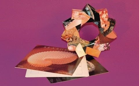 Trash Origami .  Free tutorial with pictures on how to make a recycled wreath in under 60 minutes by papercrafting and paper folding with calendar. How To posted by Tuttle Publishing.  in the Papercraft section Difficulty: Simple. Cost: Cheap. Steps: 20