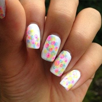 A cute and colorful manicure inspired bubbles! .  Free tutorial with pictures on how to paint patterned nail art in under 7 minutes by nail painting with acrylic paint, nail polish, and paintbrushes. Inspired by polka dot. How To posted by Bella and Esther S.  in the Beauty section Difficulty: Simple. Cost: No cost. Steps: 6