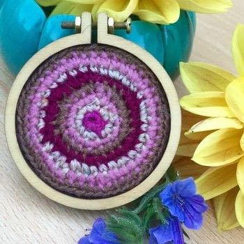 Circular crochet for home or accessorising made from Dandelyne mini embroidery heaps kit .  Free tutorial with pictures on how to make an embroidery hoop frame in under 60 minutes by crocheting with yarn, embroidery hoop, and super glue. How To posted by Frocktopus.  in the Yarncraft section Difficulty: 3/5. Cost: Cheap. Steps: 5