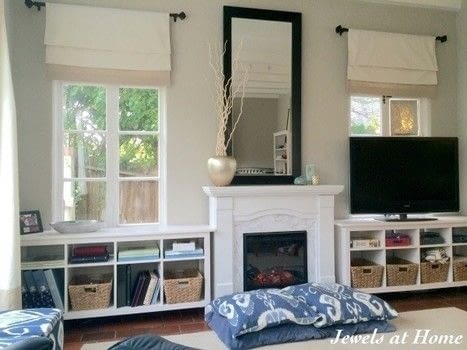 """A """"fake it 'til you make it"""" project! .  Free tutorial with pictures on how to make a fireplace in 2 steps by decorating with shelves, paint, and contact paper. Inspired by marble. How To posted by Jewels at Home.  in the Home + DIY section Difficulty: 3/5. Cost: 3/5."""