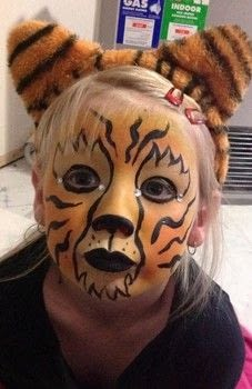 Cute tiger .  Create a face painting in under 5 minutes using face paint, paintbrushes, and diamantes. Inspired by tigers. Creation posted by Xx13.CrowsxX.  in the Beauty section Difficulty: Simple. Cost: Absolutley free.
