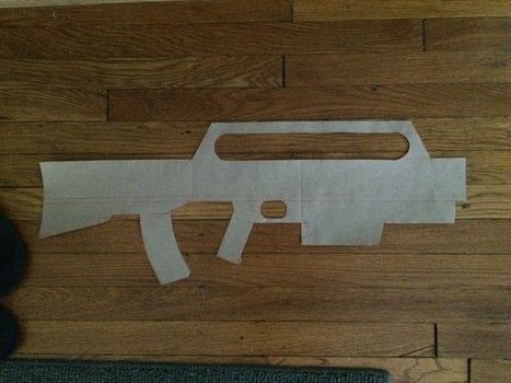 Starship Troopers Morita Rifle from scratch .  Free tutorial with pictures on how to make a weapon in 8 steps using insulation, dip, and wood glue. How To posted by Christine H.  in the Home + DIY section Difficulty: 4/5. Cost: 3/5.