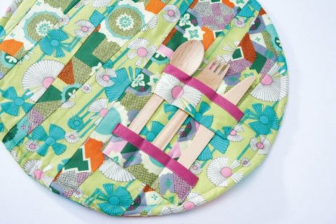 Fun with Fat Quarters .  Free tutorial with pictures on how to make a placemat in 10 steps by sewing and patchworking with fabric, fabric, and wadding. How To posted by Search Press.  in the Sewing section Difficulty: Simple. Cost: Cheap.