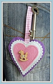 Small,Sweet & Simple-The HeartFelt KeyRing .  Free tutorial with pictures on how to sew a fabric heart charm in under 40 minutes by sewing with felt, gingham ribbon, and key ring. Inspired by birds and hearts. How To posted by Kajsa Kinsella.  in the Sewing section Difficulty: Easy. Cost: Absolutley free. Steps: 8