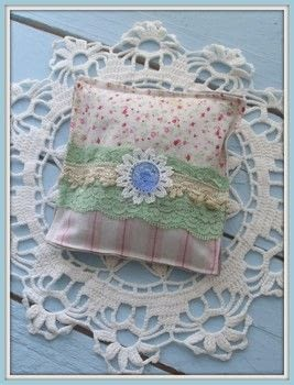 Capture summer`s fragrances .  Free tutorial with pictures on how to make a scent pouches in under 40 minutes by sewing with fabrics, glass, and linen. Inspired by flowers. How To posted by Kajsa Kinsella.  in the Sewing section Difficulty: Easy. Cost: Absolutley free. Steps: 6