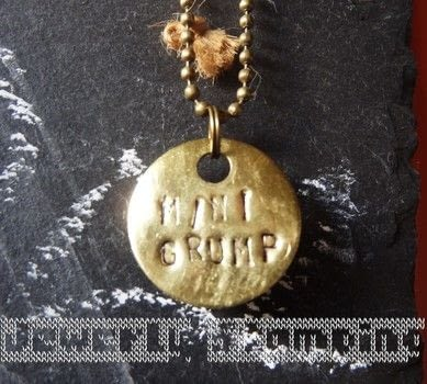 """Clonk Clonk""  .  Free tutorial with pictures on how to stamp a stamped metal pendant in under 120 minutes using hammer, stamping letters, and metal. Inspired by gifts and christmas. How To posted by Ashinezz.  in the Jewelry section Difficulty: 3/5. Cost: 3/5. Steps: 7"