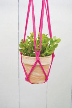 DIY T-Shirt Crafts .  Free tutorial with pictures on how to make a hanging planter in under 35 minutes by braiding with t-shirt yarn, scissors, and plant. How To posted by FW Media.  in the Other section Difficulty: Simple. Cost: Cheap. Steps: 6