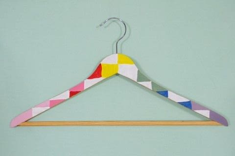 Add a pop of color to your closet with these painted wooden hangers! .  Free tutorial with pictures on how to make a clothes hanger in under 30 minutes by decorating with acrylic paint, paint brush, and hanger. How To posted by CozyReverie.  in the Art section Difficulty: Simple. Cost: No cost. Steps: 5