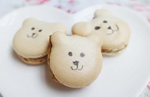 Adorable bear shaped macaroons .  Free tutorial with pictures on how to bake a macaron in under 25 minutes by cooking and baking with icing sugar, ground almonds, and granulated sugar. Inspired by bears. Recipe posted by Cat Morley.  in the Recipes section Difficulty: Simple. Cost: Cheap. Steps: 7