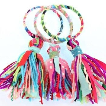 Make huge boho tassels with scrap fabric and trims .  Free tutorial with pictures on how to make a fabric bracelet in under 30 minutes by jewelrymaking and yarncrafting with zip ties, glue gun, and fabric scraps. How To posted by Mark Montano.  in the Jewelry section Difficulty: Easy. Cost: Absolutley free. Steps: 4