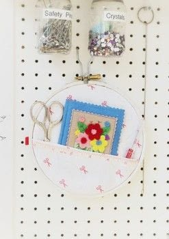 Turn an old embroidery hoop into a one stop sewing kit! .  Free tutorial with pictures on how to make a sewing kits in under 25 minutes by sewing with embroidery hoop, fabric, and tape measure. How To posted by Cat Morley.  in the Sewing section Difficulty: Simple. Cost: Cheap. Steps: 11