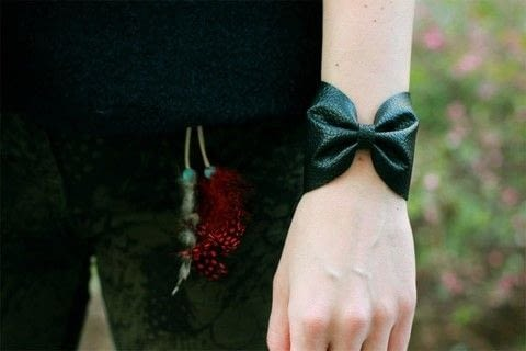 An easy and pretty bow faux leather bracelet. .  Free tutorial with pictures on how to make a leather cuff in under 30 minutes by jewelrymaking with thread, buttons, and needle. How To posted by Sarah H.  in the Sewing section Difficulty: Easy. Cost: Absolutley free. Steps: 3