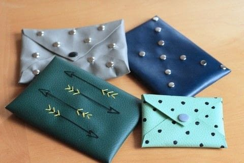 Easy and pretty little envelope clutches. .  Free tutorial with pictures on how to make an envelope clutch in under 15 minutes by sewing with scissors, glue, and pens. How To posted by Sarah H.  in the Other section Difficulty: Easy. Cost: Absolutley free. Steps: 4