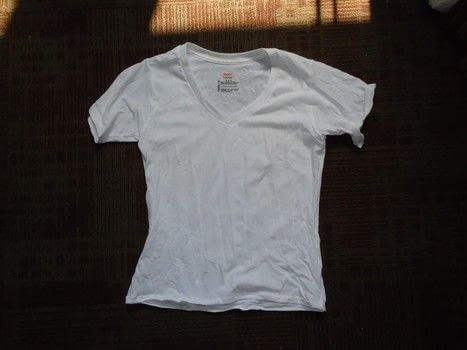 Making a standard men's shirt into a fitted women't shirt. .  Make a revamped t-shirt in under 60 minutes using t shirt, sewing machine, and scissors. Creation posted by Rachel's Craft Channel.  in the Sewing section Difficulty: Easy. Cost: Cheap.