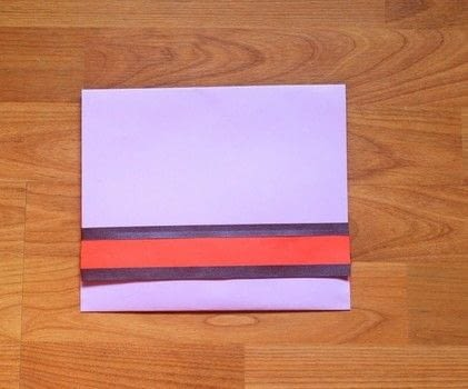 Don't need to buy envelopes! .  Free tutorial with pictures on how to make an envelope in under 15 minutes by papercrafting with scissors, colored paper, and ribbons. Inspired by gifts. How To posted by The Craftables.  in the Papercraft section Difficulty: Easy. Cost: No cost. Steps: 7