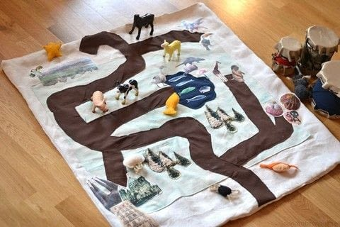 DIY a personal and fun play mat .  Free tutorial with pictures on how to make a play mat in under 180 minutes by sewing with scissors, sewing machine, and glue. How To posted by Sandra B.  in the Home + DIY section Difficulty: 3/5. Cost: Cheap. Steps: 3