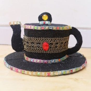 Host your own Mad Hatter's tea party with a teapot top hat! .  Free tutorial with pictures on how to make a top hat in under 120 minutes by decorating and embellishing with card, scissors, and pencil. Inspired by alice in wonderland and costumes & cosplay. How To posted by Cat Morley.  in the Decorating section Difficulty: Simple. Cost: Cheap. Steps: 27