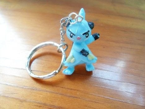 Pokemon key chain .  Make a charm / keyring in under 30 minutes using key ring, jewlery pliers, and action figure. Inspired by pokemon and comic books. Creation posted by Luna.  in the Other section Difficulty: Easy. Cost: Cheap.