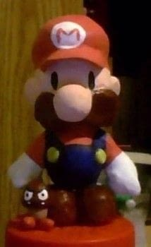 A clay figurine of paper Mario, with a photo bombing goomba:) .  Sculpt a clay superhero by constructing and  with sculpting clay and paints. Creation posted by Torhuu.  in the Art section Difficulty: 4/5. Cost: Absolutley free.
