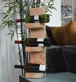 Cheap + Easy .  Free tutorial with pictures on how to make a wine rack in under 60 minutes by constructing and woodworking with wood, handles, and drill. How To posted by Crafterella.  in the Home + DIY section Difficulty: Simple. Cost: Cheap. Steps: 3