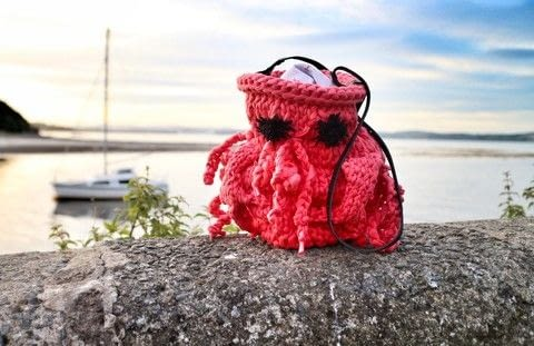 Turn a bag into a cute lobster with crochet legs and claws! .  Free tutorial with pictures on how to stitch a knit or crochet bag in under 180 minutes by crocheting and knitting with bag, t-shirt yarn, and crochet needle. Inspired by lobsters. How To posted by Cat Morley.  in the Yarncraft section Difficulty: Simple. Cost: Cheap. Steps: 23