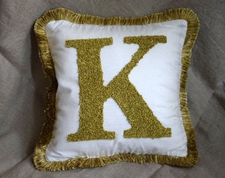 Block Letter Monogram Pillow .  Free tutorial with pictures on how to make an embellished cushion in 5 steps by decorating with embroidery thread, embroidery hoop, and letter. How To posted by Nourish and Nestle.  in the Needlework section Difficulty: Simple. Cost: Cheap.