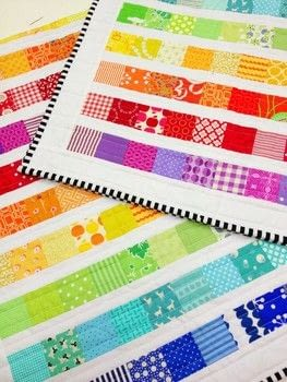 Make your own Rainbow Scrap Strip Quilt .  Free tutorial with pictures on how to make a patchwork quilt in 5 steps using fabrics, fabrics, and fabrics. Inspired by rainbow. How To posted by Emma Jean Jansen.  in the Sewing section Difficulty: Simple. Cost: Cheap.