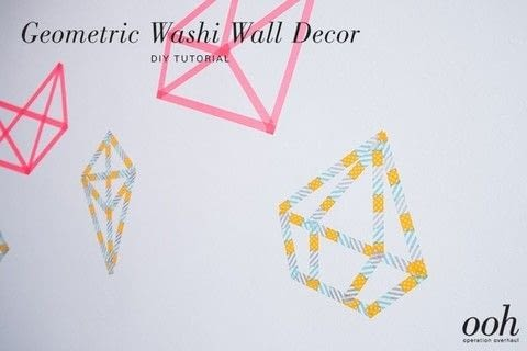 A simple and quick way to dress up a plain wall! .  Free tutorial with pictures on how to make a wall decal in under 20 minutes by decorating with washi tape and scissors. Inspired by geometric. How To posted by Operation Overhaul.  in the Decorating section Difficulty: Easy. Cost: Absolutley free. Steps: 7