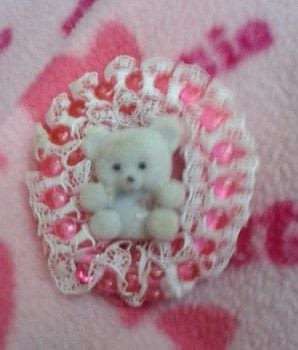 Teddy Ornament .  Make an ornament in under 60 minutes using hot glue gun sticks, pipe cleaners, and lace. Creation posted by Southern Crafter.  in the Other section Difficulty: Easy. Cost: Cheap.