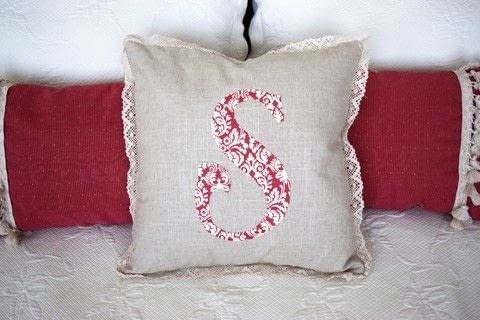 Hand-Appliqued Monogrammed Pillow .  Free tutorial with pictures on how to sew an applique cushion in 13 steps by hand sewing and machine sewing with scissors, iron, and straight pins. How To posted by Nourish and Nestle.  in the Sewing section Difficulty: Easy. Cost: Cheap.