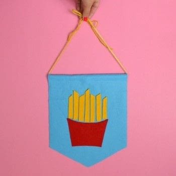 Junk Food Junkie? Show your love with some French fry wall art! .  Free tutorial with pictures on how to make a fabric collage in under 30 minutes by sewing with scissors, felt, and hot glue gun. How To posted by CozyReverie.  in the Art section Difficulty: Simple. Cost: No cost. Steps: 6