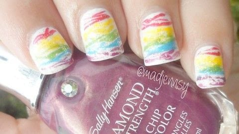 It's time for a fun and colorful design!  .  Free tutorial with pictures on how to paint a marbled nail in under 60 minutes using base coat, nail polish, and top coat. Inspired by rainbow. How To posted by Jennifer R.  in the Beauty section Difficulty: Easy. Cost: Cheap. Steps: 1