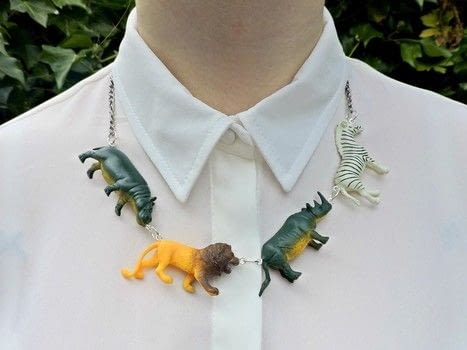 A quick and easy statement necklace .  Free tutorial with pictures on how to make a toy necklace in under 20 minutes using screw in eye hook, jump rings, and plastic animals. Inspired by animals, lions, and hippopotamus. How To posted by Eleanor.  in the Jewelry section Difficulty: Easy. Cost: Cheap. Steps: 5