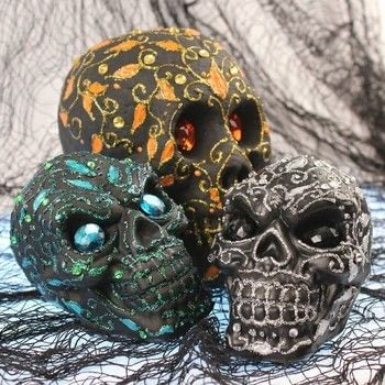 Turn cheap plastic skulls into chic Halloween decor! .  Free tutorial with pictures on how to decorate a skull in under 60 minutes by creating, spraypainting, embellishing, and cake decorating with allure dimensional design adhesive paint, americana multi surface satin, and plastic. Inspired by halloween and skulls & skeletons. How To posted by Mark Montano.  in the Art section Difficulty: Easy. Cost: Cheap. Steps: 3