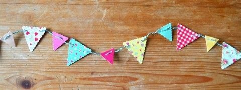 Card bunting .  Free tutorial with pictures on how to make bunting in under 30 minutes by papercrafting with scissors, needle, and pin. How To posted by Adventures and Tea Parties.  in the Papercraft section Difficulty: Easy. Cost: Cheap. Steps: 6