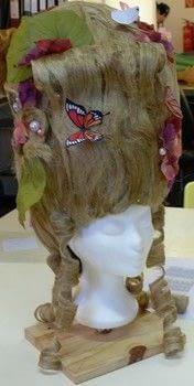 A Rococo style wig for theater .  Make a wig by paper folding and embellishing with stapler, hemp, and staples. Creation posted by Maladignia.  in the Other section Difficulty: Simple. Cost: 3/5.