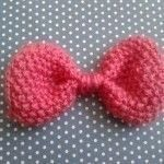 Super simple knitted bow .  Free tutorial with pictures on how to stitch a knit or crochet bow brooch in under 30 minutes by knitting with knitting yarn, knitting needles, and darning needle. How To posted by Buttons and Pickles.  in the Yarncraft section Difficulty: Easy. Cost: No cost. Steps: 3