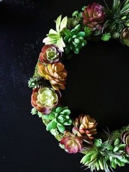 Beautiful faux succulent wreath created on a budget.  .  Free tutorial with pictures on how to make a wreath in under 60 minutes by decorating and gardening with pins, wire cutters, and hot glue. How To posted by Domicile 37.  in the Decorating section Difficulty: Easy. Cost: Cheap. Steps: 2